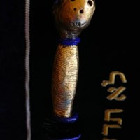 L'épée, vue 3, premier visage